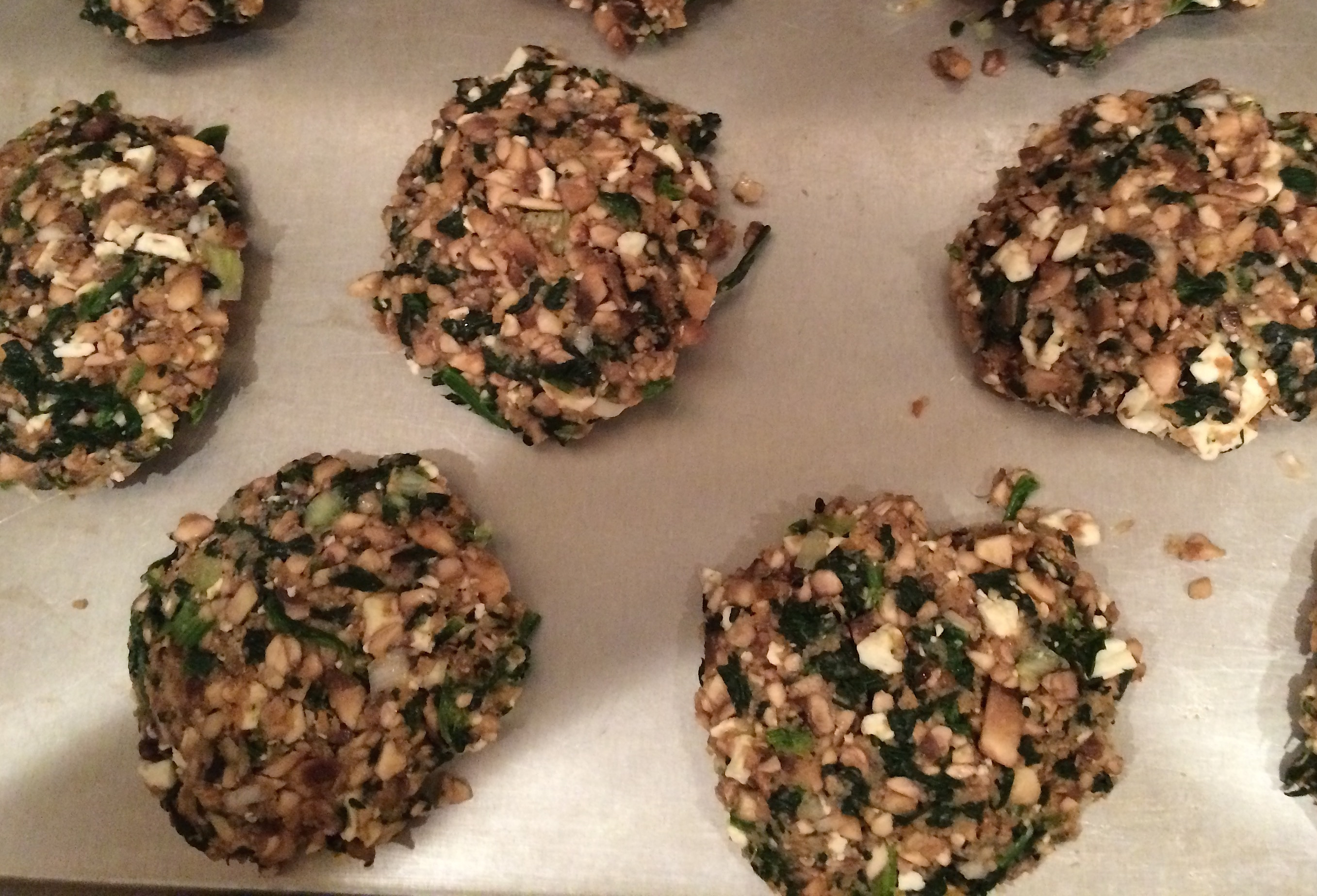 Uncooked Spinach, Mushroom and Feta patties on baking sheetIMG_2124